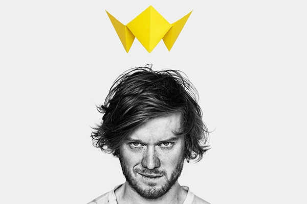 Macbeth Muet Promotional Image featuring mans face with a yellow digital crown floating above his head.